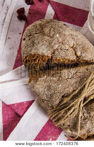 homemade brown bread on a red and white cloth