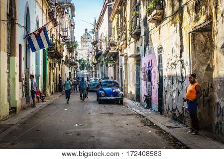Cuban street view with people and cuban flag on december 26 2016 in La Havana Cuba