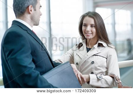 Businesswoman and businessman talking together