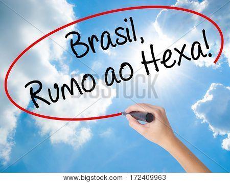 Woman Hand Writing Brasil, Rumo Ao Hexa! With Black Marker On Visual Screen.