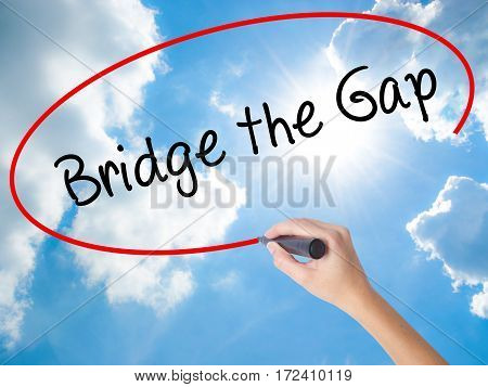 Woman Hand Writing Bridge The Gap With Black Marker On Visual Screen