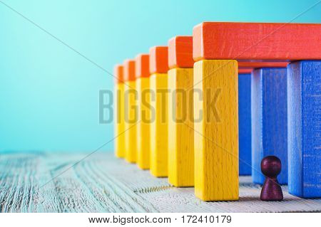 Abstract man into the colorful wooden corridor with copy space. Concept of success. Abstract man in a multicolored wooden tunnel.