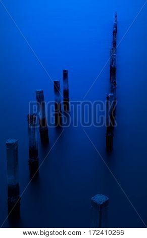Wooden posts in perspective on the sea