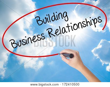 Woman Hand Writing  Building Business Relationships  With Black Marker On Visual Screen