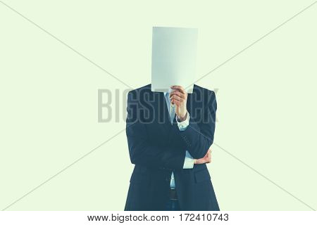 Businessman holding a folders near face isolated on white background .