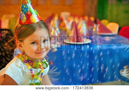 Young girl seated at her birthday table