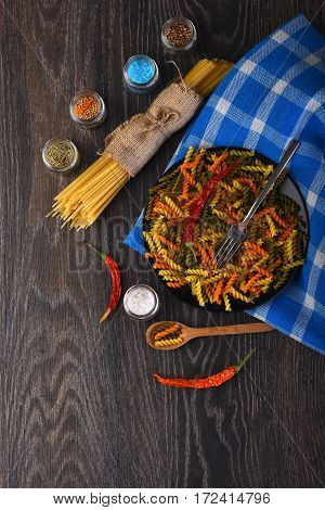 Dried Italian Pasta On Blue Plaid Tablecloth