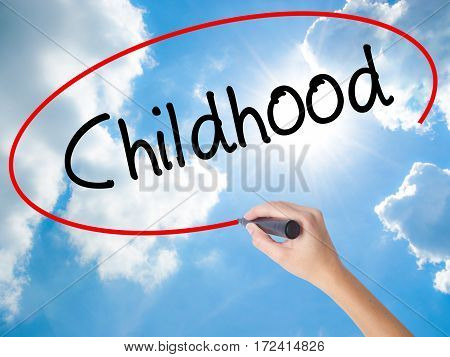 Woman Hand Writing Childhood With Black Marker On Visual Screen