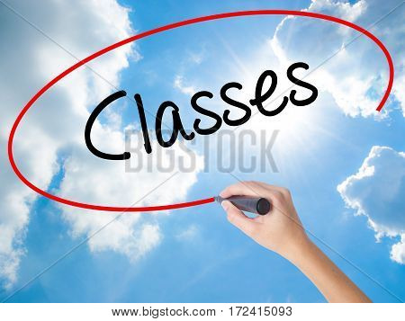 Woman Hand Writing Classes   With Black Marker On Visual Screen