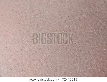Texture of young woman's skin closeup shooting
