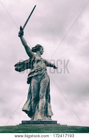 Popular touristic landmark Monument Motherland. Mamayev Hill located in Volgograd Russia. Dramatic filter.