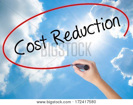 Woman Hand Writing Cost Reduction With Black Marker On Visual Screen