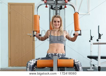 The Girl In The Gym Does Physical Exercises