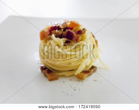 Spaghetti carborara. Ingredients: pasta eggs bacon pecorino cheese salt and pepper. Ready meal white background.
