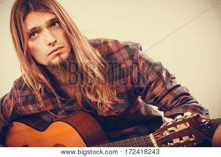 Sitting Man Playing Guitar.