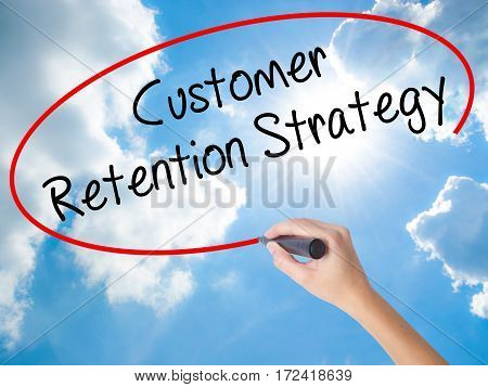 Woman Hand Writing Customer Retention Strategy With Black Marker On Visual Screen