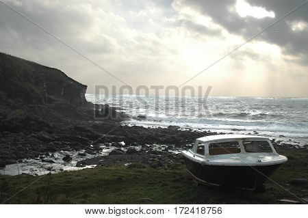 A Small Boat sitting beside the sea on the Aberdeenshire Coastline