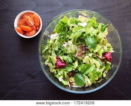 Fresh vegetable salad, healthy food, tomatoes and salad leaves. Healthy chicken salad with fresh vegetables