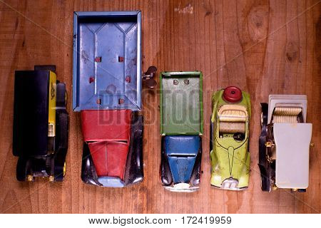 Vintage Toy Cars (lorry (truck) And Convertible Car)  On Brown Wooden Background. Retro Toys For Boy