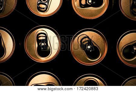 Open cans with golden top part. Closeup. Background. Macro image can be used as background.