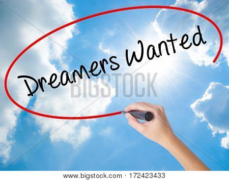 Woman Hand Writing Dreamers Wanted  With Black Marker On Visual Screen