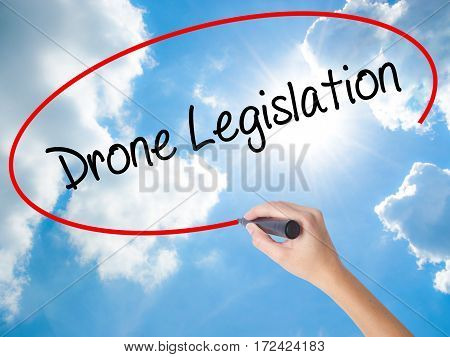 Woman Hand Writing Drone Legislation With Black Marker On Visual Screen