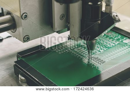 Automation of machine assembly of computer circuit board in the factory for the production of computer components. The process of soldering the board. Factory for the production of microchips.
