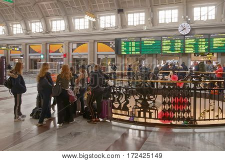 STOCKHOLM SWEDEN - MAY 05 2016: Group of girls waiting in the central train station hall. May 05 2016 Stockholm Sweden