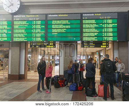 STOCKHOLM SWEDEN - MAY 05 2016: Family waiting in the central train station hall. May 05 2016 Stockholm Sweden