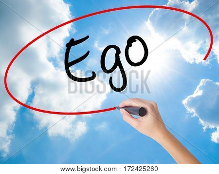 Woman Hand Writing Ego With Black Marker On Visual Screen