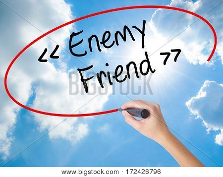Woman Hand Writing Enemy - Friend With Black Marker On Visual Screen.