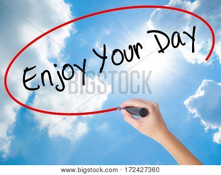 Woman Hand Writing Enjoy Your Day With Black Marker On Visual Screen
