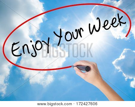 Woman Hand Writing Enjoy Your Week With Black Marker On Visual Screen