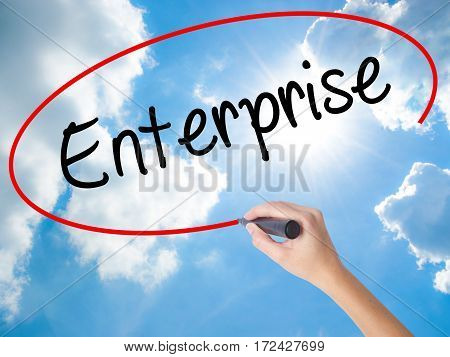Woman Hand Writing Enterprise With Black Marker On Visual Screen