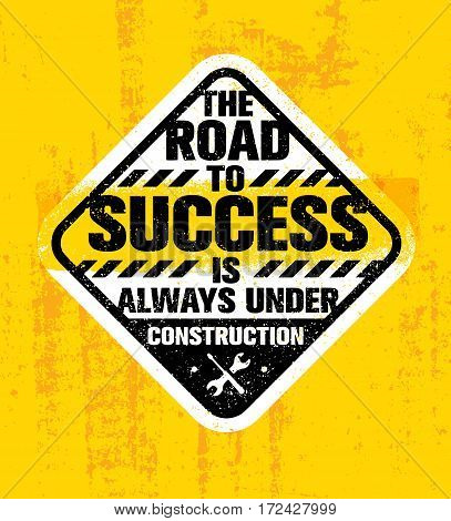 The Road To Success Is Always Under Construction. Inspiring Creative Motivation Quote. Rough Vector Typography Sign Design Concept On Grunge Wall Background