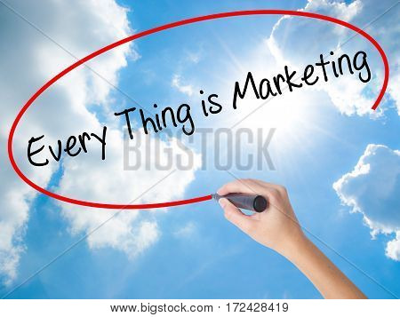 Woman Hand Writing  Every Thing Is Marketing With Black Marker On Visual Screen