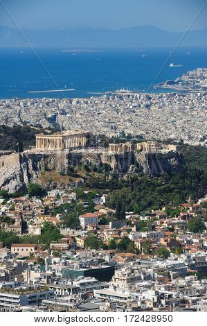 Athens Greece - April 27, 2016: Famous view from Lycabettus hill to modern city with Acropolis ans sea at background