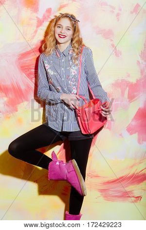 Cheerful Pretty Girl In Pink Ugg Boots With Stylish Bag