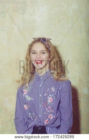 Cheerful Pretty Girl In Blue Striped Shirt And Headband