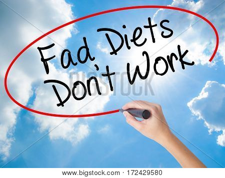 Woman Hand Writing Fad Diets Don't Work With Black Marker On Visual Screen