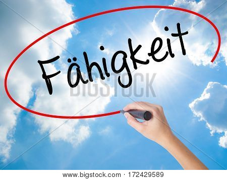 Woman Hand Writing Fahigkeit (ability In German) With Black Marker On Visual Screen