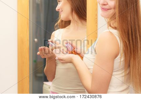 Woman Taking Care Of Her Long Hair Applying Cosmetic Oil