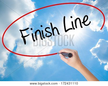 Woman Hand Writing Finish Line With Black Marker On Visual Screen