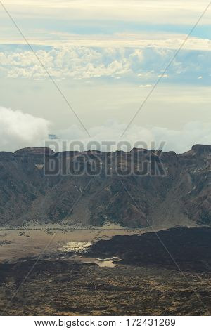 Idyllic Black Volcanic Mountain Tops And Crater