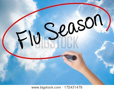 Woman Hand Writing  Flu Season With Black Marker On Visual Screen