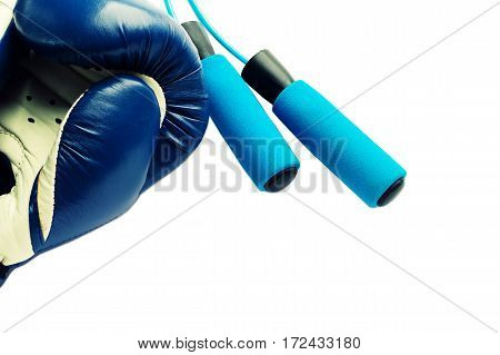 Fitness concept - boxing glove with skipping rope.
