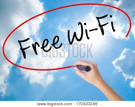 Woman Hand Writing Free Wi-fi  With Black Marker On Visual Screen