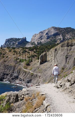 VILLAGE NOVY SVET, Crimea- September 17, 2015. A man walks along a mountain path along the sea. The trail Golitsyn.