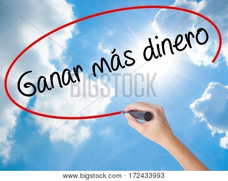 Woman Hand Writing  Ganar Mas Dinero  (make More Money In Spanish)  With Black Marker On Visual Scre