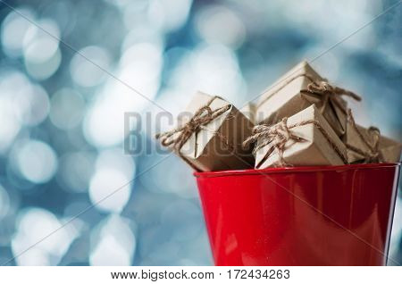 Gift boxes in red bucket Christmas and New Year concept. copy space.